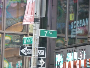 a NYC street sign 7ave 44st