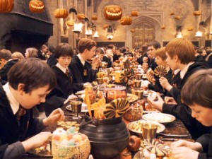 "The movie ""Harry Potter and the Sorcerer's Stone"", (alt.: Harry Potter and the Philosopher's Stone), directed by Chris Columbus, based on the novel by J.K. Rowling.  Seen here, Halloween celebration in Hogwarts dining room.  Initial world premiere (London) November 4, 2001.  Screen capture. © 2001 Warner Bros. Credit: © 2001 Warner Bros. / Flickr / Courtesy Pikturz.  Image intended only for use to help promote the film, in an editorial, non-commercial context."